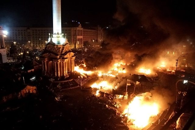 "Burning Central Kiev represents a new stage of ""Eurointergation"". Photo taken on the Independence square in February 2014."