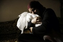 A woman holds the body of her daughter, who medics said died on Friday from injuries sustained in an Israeli air strike on Thursday afternoon, at her funeral in Rafah